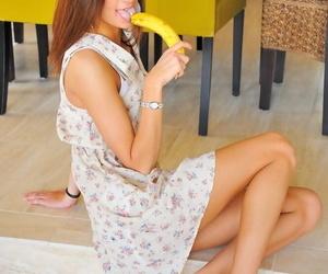 Acrobatic brunette in sexy dress sucks and fucks a banana