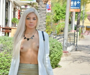 Incredibly beautiful blonde fingers her juicy twat in public
