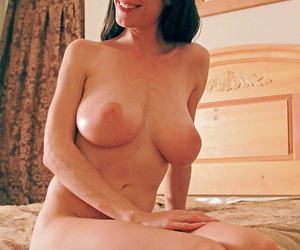 Busty amateur Michelle toys with her glass dildo letting her heavy boobs hang