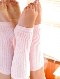 Flexible teen babe Baby Dream showing off sexy legs and feet in leg warmers