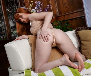 Older redhead Marie McCray displaying unadorned legs before loosing on the mark gut