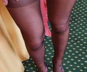 Naughty mature woman Lady Sarah revealing pierced pussy under panties