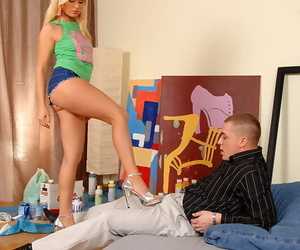 Blonde Kathy Sweet is giving a footjob to a foot fetishist