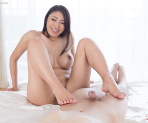 Horny Asian hottie gives a sexy footjob to get toes soaked in sticky cum