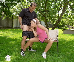 Sporty girl and her mom tag team the tennis instructor outdoors at the club