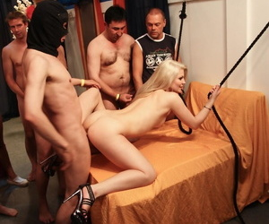 Blonde cutie shows her flexible skills before she gets gangbanged