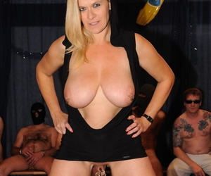 Heavy boobed tow-haired tolerant offers up the brush pierced twat for everyone over for everyone cocks in a gangbang