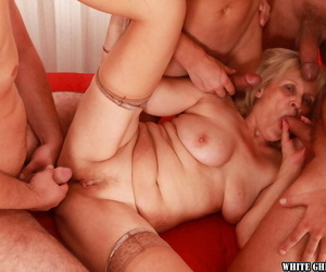 Lascivious granny gets blowbanged and fucked off out of one\'s mind four well-hung guys