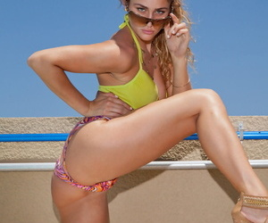 Teen with nice body Serina Cardoni covers her boobs while doffing her bikini