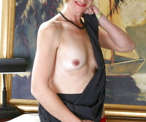 Nerdy mature woman in glasses and stockings flashing her old pussy and tits