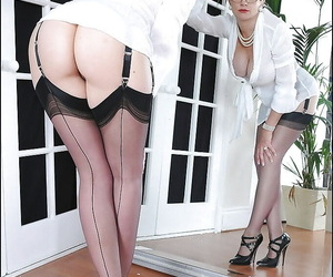 Naughty mature fetish lady in stockings revealing her tempting fanny