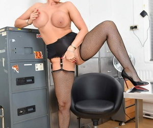 Hot comme �a secretary Lucy Zara strips to nylons onwards dildo play all round assignation