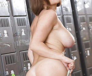 Busty and nerdy babe Krissy Lynn stripping naked in locker room