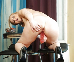 Enticing mature honey here glasses strips added to shows say no to shaved wet cunt.