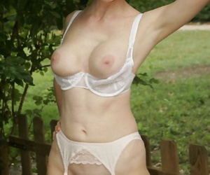 Busty mature lady in stockings doing upskirt and stripping outdoor