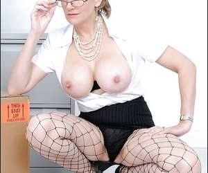 Sexy mature babe in fishnet pantyhose uncovering her big boobs