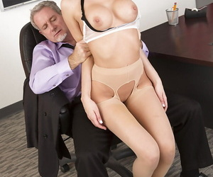 Glasses clad teacher Riley Steele receiving oral sex from principal