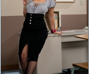 Mature teacher in glasses Shay Morgan stripping to fencenet stockings