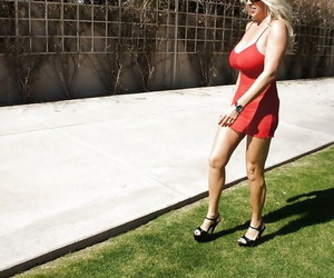 Sexy mature lady in red dress and sun glasses Wifey posing outdoor