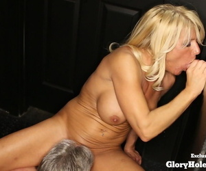 Blonde slut spits and swallows jizz while sucking cock at a gloryhole