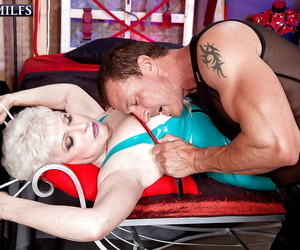 Latex clad granny with saggy tits engaging in hardcore BDSM sex