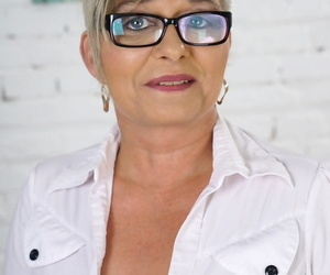 Glasses-clad mature granny Jessye sheds selfish jeans to bearing nice bosom & nuisance