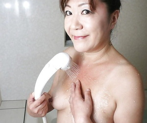 Vicious asian granny with rich brighten tits and hairy line cut taking shower