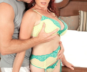 Red-haired mature with big boobs Karen Kougar takes guys dick in each hole