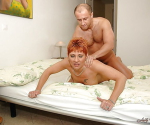 Short haired granny gives a blowjob and gets pounded in a catch bath