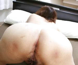 Asian granny Michiko Okawa gives a sensual blowjob and gets fucked