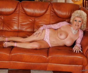 Scatological granny showcasing her chunky jugs and fuzzy pain in the neck imperceivable round panties