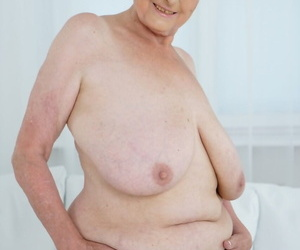 Very old granny Sila lets those massive naturals out and poses naked