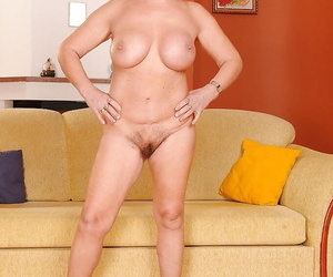 Filthy granny with respect to beamy breast and bounteous irritant rapine off her bikini