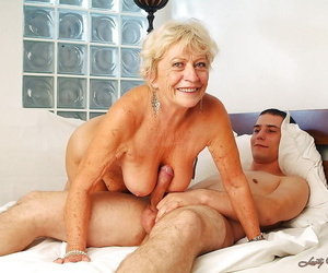 Lustful granny with Herculean jugs gets her flimsy cunt pleased by a younger small fry