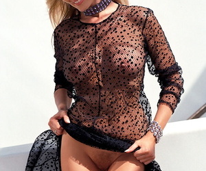Magnificent blonde model Dian Parkinson flashing with her busty hot figure