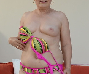 Blonde granny at hand colorful unmentionables Ursula Grande pinpointing the brush twat