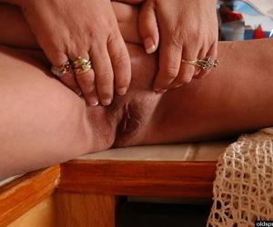 Full-grown golden granny Ivy masturbating her nicely shaved vagina