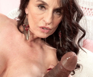 Hot grown up doll Rita Daniels seduces a black pencil more a red dress