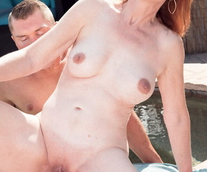Mature redhead Diamond In flames goes pussy to mouth with a younger guy