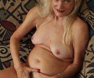 Undressing scene features blonde granny Lisa Cognee in her panties