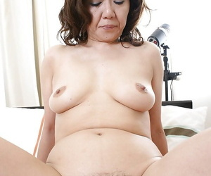 Asian lady Eriko Nishimura gives a blowjob and gets her shaggy twat boned-up