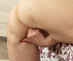 Hot granny Karoline spreading legs and finger going to bed shaved full-grown pussy