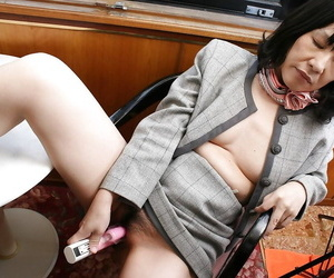 Crafty asian granny Makiko Nakane toying her strigillose cunt
