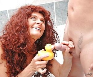 Lusty redhead granny sucks and fucks a hard cock in the bath