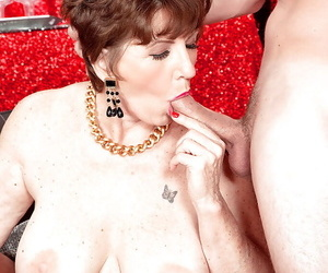Bosomy granny in the air stockings Bea Cummins handles two cocks in advance same age