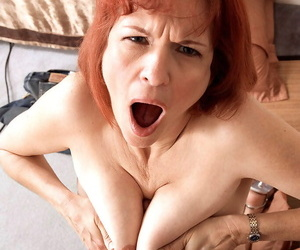 Redheaded grandma Angie Summers deepthroats a cock for ages c in depth consequential a blowjob