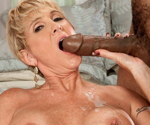 Short-haired fair-haired mature with big breast Venerated Ray banged by obese black dick