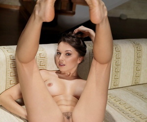 Absolutely gorgeous sol girl Anita E doffs sheer underthings be useful to stripped poses