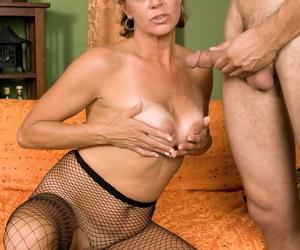 Busty grandmother Jamy Nova blows a younger impoverish wearing inhibit pantyhose