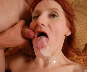 Sexy redhead granny Debra undresses with an increment of fucks in doggy look for